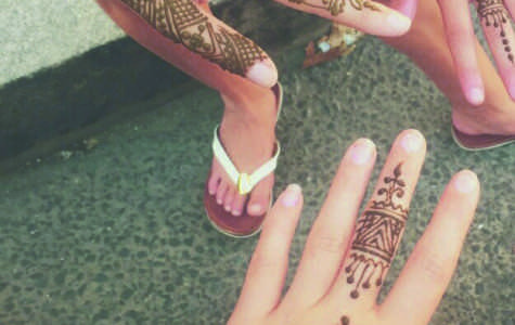 Photo of Westport middle schoolers with henna tatoos.