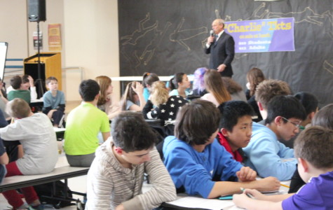 Attorney Jim Whalen speaks to eighth graders about being a trial lawyer before mock trials.