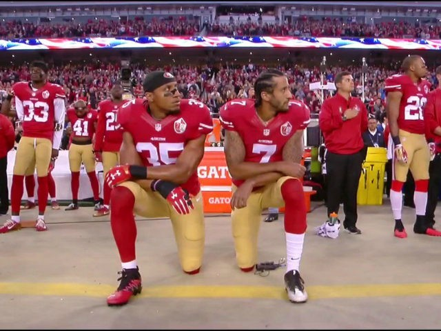 Eric Reid and Colin Kaepernick kneel during a preseason football game protesting police brutality.