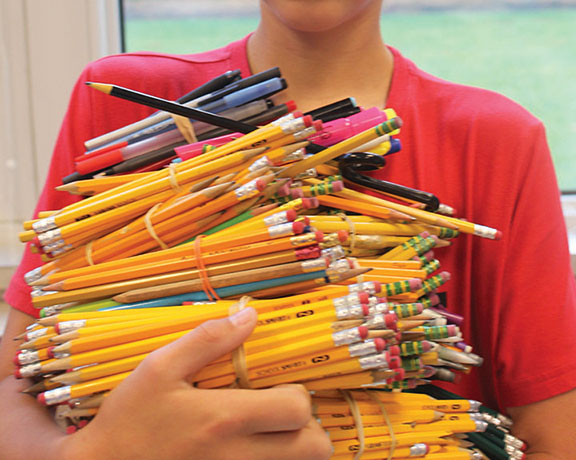 The writer with his collection of pencils collected over one year.