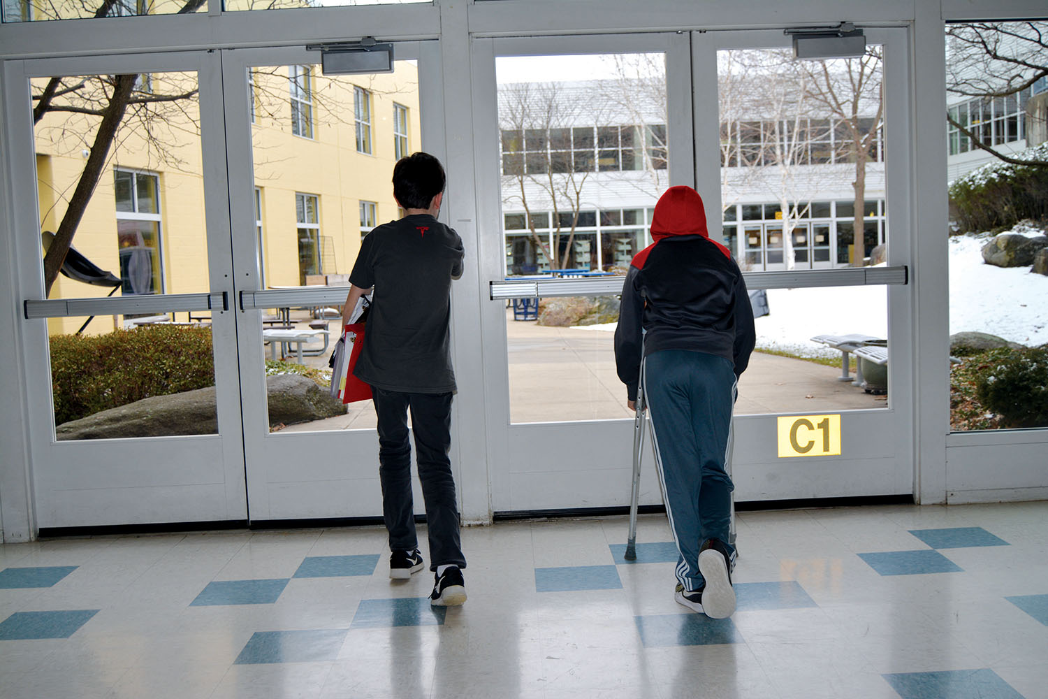 To help those on crutches, BMS has student helpers to carry binders.