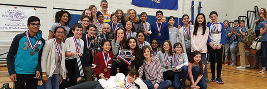 Bedford's Science Olympiad team celebrates a win after many hours of hard work since the school year began.