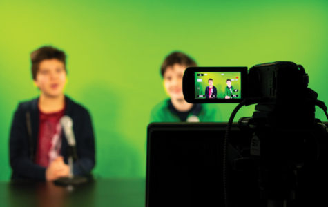 BCTV Hosts Cooper Sadler and Curtis Sullivan in front of the green screen airing a new episode of BCTV.