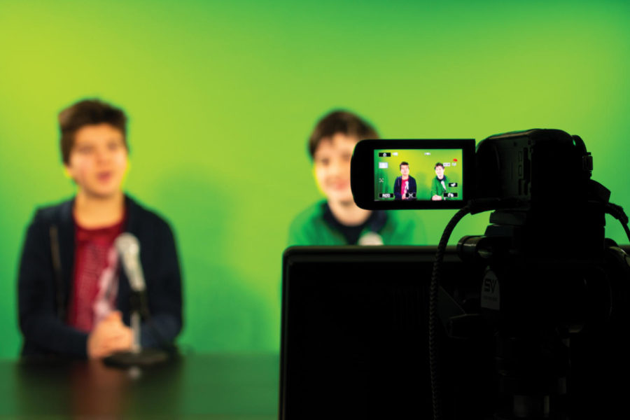 +BCTV+Hosts+Cooper+Sadler+and+Curtis+Sullivan+in+front+of+the+green+screen+airing+a+new+episode+of+BCTV.