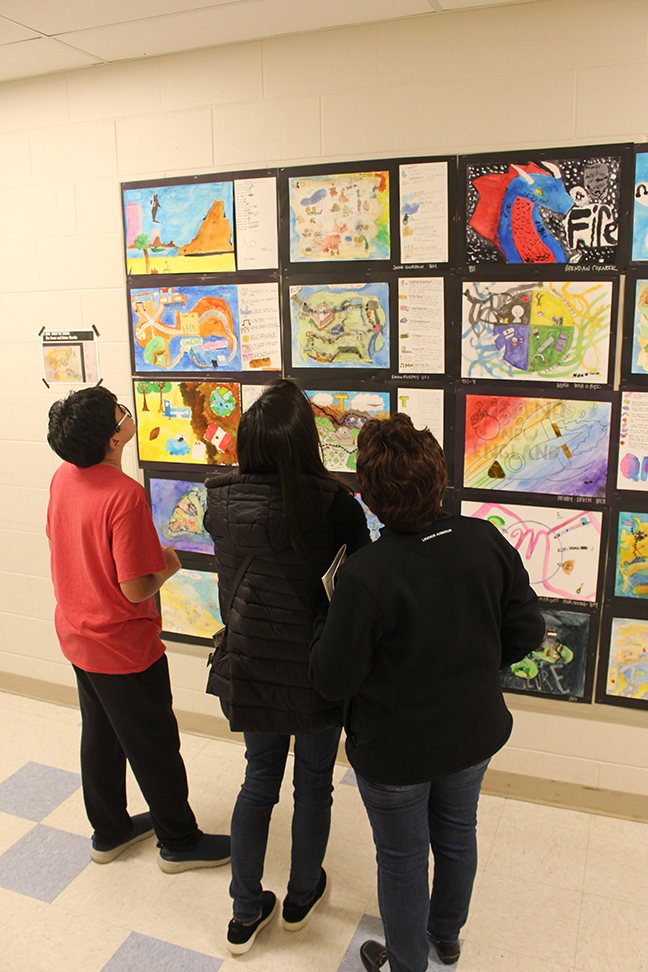 "An eighth grader and family admire student ""life maps,"" islands that represent their lives and personalities."