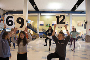"Sixth graders practicing ""Three is a Magic Number"" in the cafeteria."