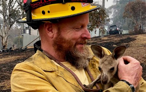 Captain Soldavini with baby kangaroo in January. The fires have destroyed homes, and they have killed people and wildlife.
