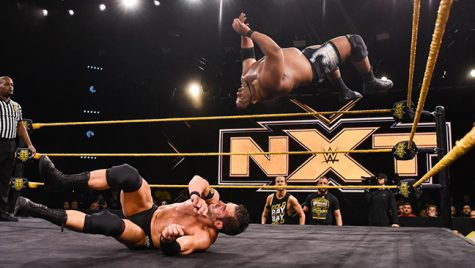"Roderick Strong trying to avoid a moonsault by ""limitless"" Keith Lee during WWE's NXT."