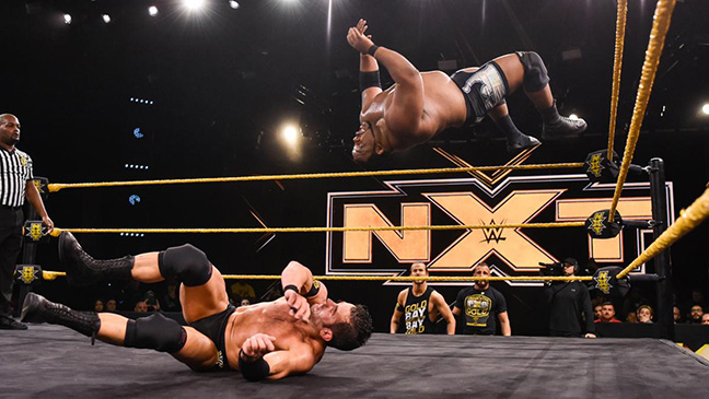 Roderick+Strong+trying+to+avoid+a+moonsault+by+%E2%80%9Climitless%E2%80%9D+Keith+Lee+during+WWE%E2%80%99s+NXT.