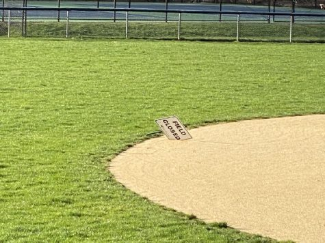 "A ""Field Closed"" sign on Rogers Field serves as a reminder of baseball on hold. While a similar sign has been positioned on Compo Beach Field since the summer, the notices have proliferated across town as the Westport Parks and Recreation Department closed the rest of their baseball fields."