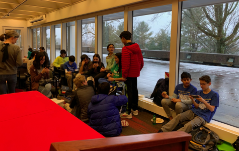 Groups of Bedford Middle School Science Olympiad students joke around, study to prepare for their events, and help each other out.